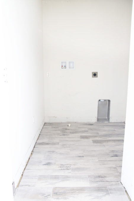 Final Tiled Floor in a Laundry Room