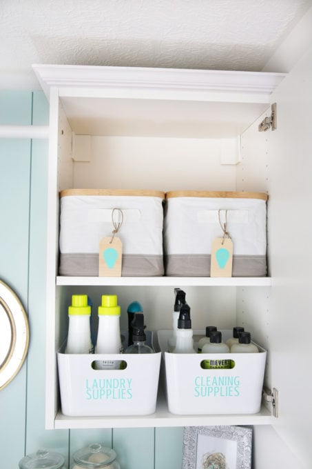 Organized Cabinet with Laundry Supplies, Cleaning Supplies, and Light Bulbs