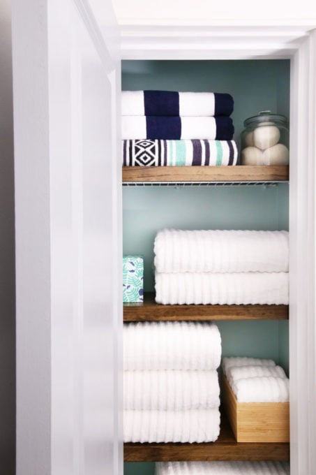 Organized Small Linen Closet with Folded Towels