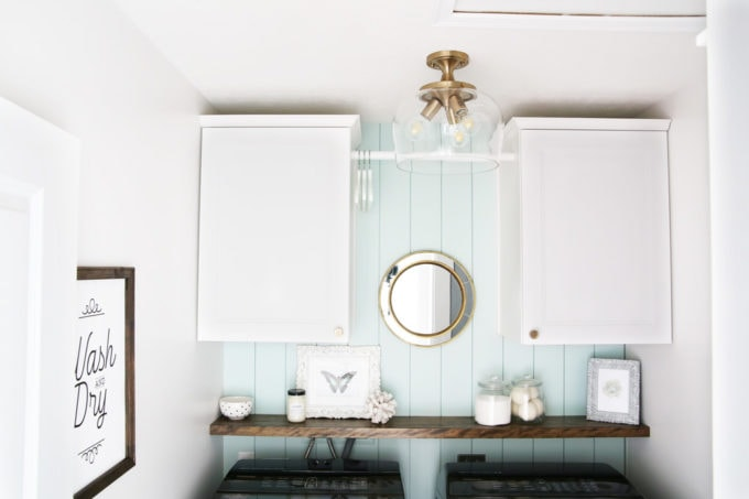 Small Laundry Room with Cabinets and Shelf