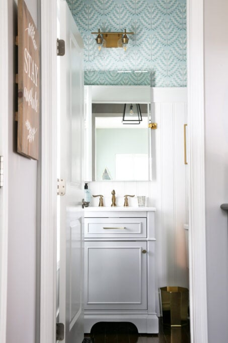 Aqua, Gray, and White Powder Room with Brass Fixtures
