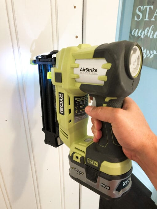 Using Brad Nailer to Attach Wainscoting in Half Bathroom