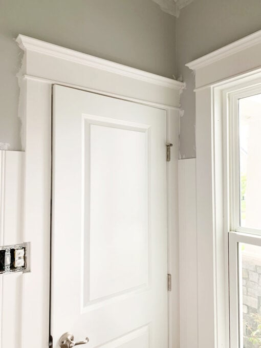Craftsman Style Window Trim on Door and Window in Half Bath