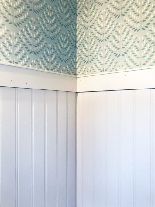 Top Trim Piece Installed on Wainscoting in Powder Room