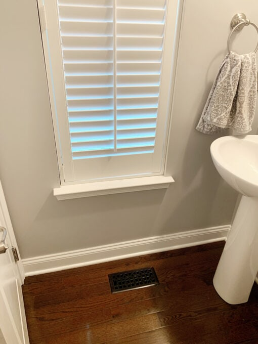 Basic Baseboards and Window Trim in a Half Bathroom
