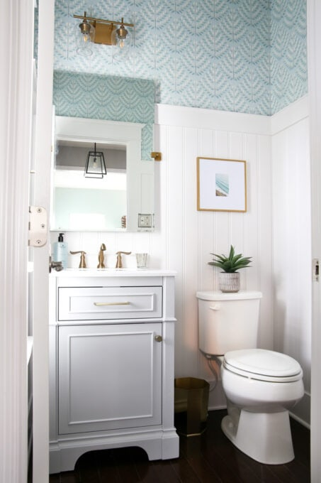 Finished Powder Room with Aqua Wallpaper Installed