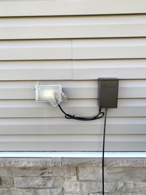 Transformer Hanging on Side of House