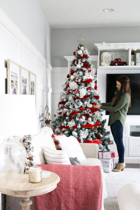 Decorating a Classic Christmas Tree in a Living Room
