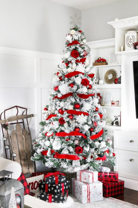 Full Red and White Christmas Tree with Wrapped Gifts