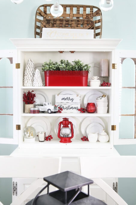 White China Cabinet Decorated for Christmas