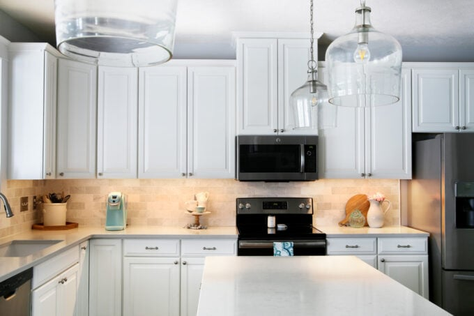White kitchen with under cabinet lighting installed