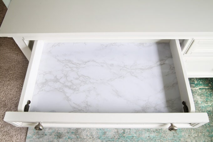 Desk drawer lined with marble contact paper