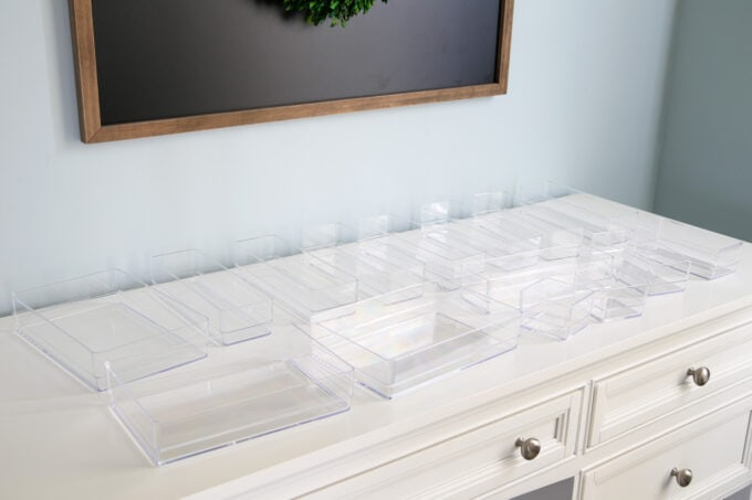 Clear bins to organize a desk drawer