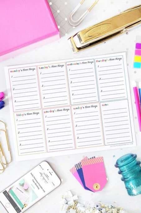 flatlay of daily three things productivity printable with office supplies around it