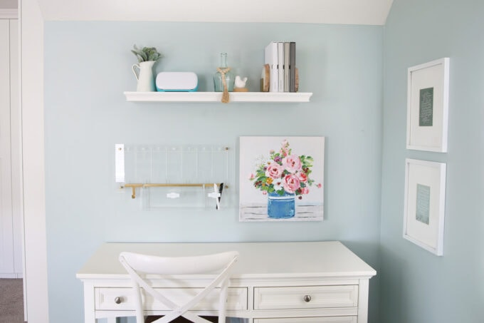 Organized Desk with Acrylic Wall Calendar and White Floating Shelf