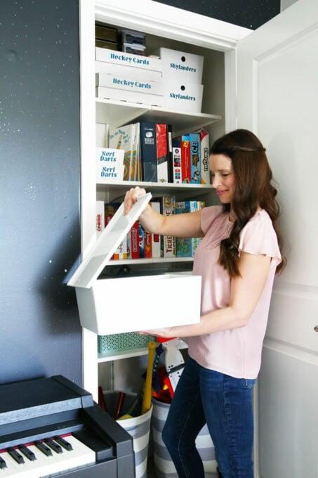 mom looking through toy bins in playroom
